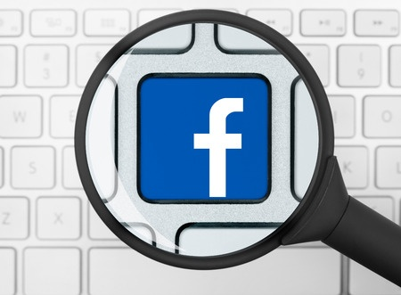 37758222 - facebook icon under the magnifying glass